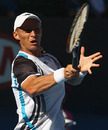 Nikolay Davydenko hits a forehand during his quarter-finals clash with Roger Federer