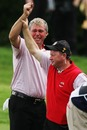 Darren Clarke is congratulated by Ian Woosnam on the 16th green