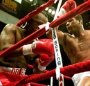 Riddick Bowe knocks challenger Michael Dokes into the ropes