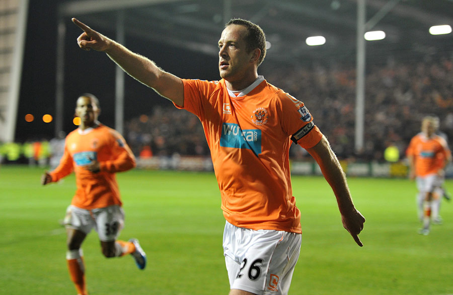 Charlie Adam celebrates scoring his penalty