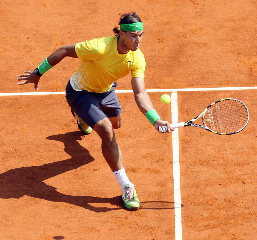 23347 - Rafael Nadal coasts into last four
