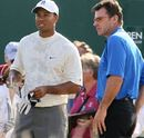 Tiger Woods and Nick Faldo stare into the distance