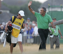 Seve Ballesteros walks on to the green with his caddie son Baldomero