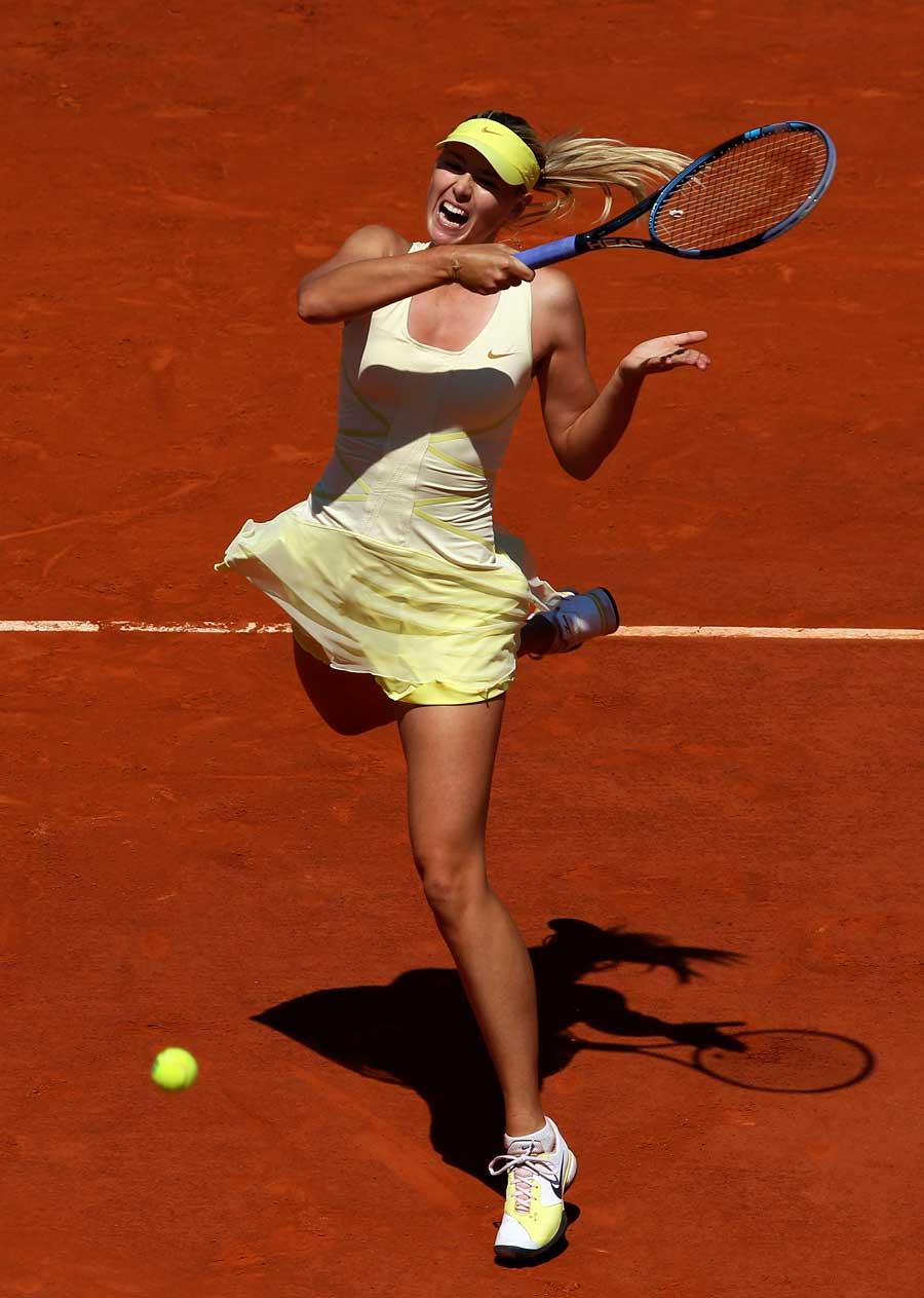 25297 - Sizzling Sharapova powers past Petkovic