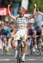Mark Cavendish of Great Britain and Team Columbia-HTC crosses the finish line to win Stage 21 of the Tour de France