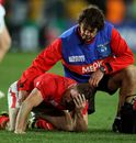 Shane Williams lies dejected as he is comforted by team physio Mark Davies