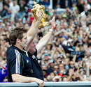RIchie McCaw and Graham Henry hold the trophy aloft