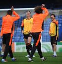 John Terry and Juan Mata laugh during a training session