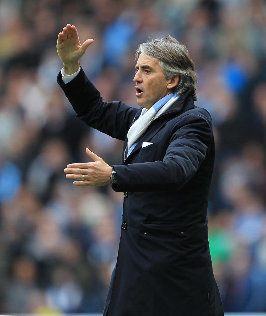 36410 - Mancini hoping for United slip-up