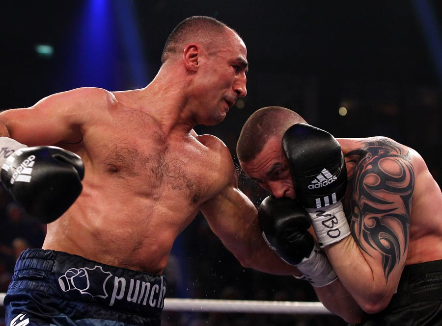 Arthur Abraham exchanges punches with Piotr Wilczewski