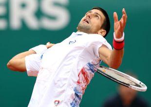 371242 - Unhappy Djokovic sneaks into third round