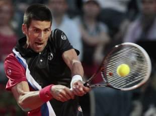 381742 - Djokovic overwhelms Federer to set up Nadal final