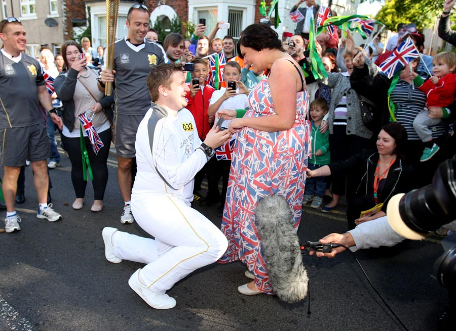 Torchbearer David State stops midway through his Torch Relay leg to propose