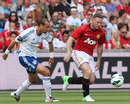 Wayne Rooney runs with the ball