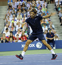 Roger Federer plays a backhand volley