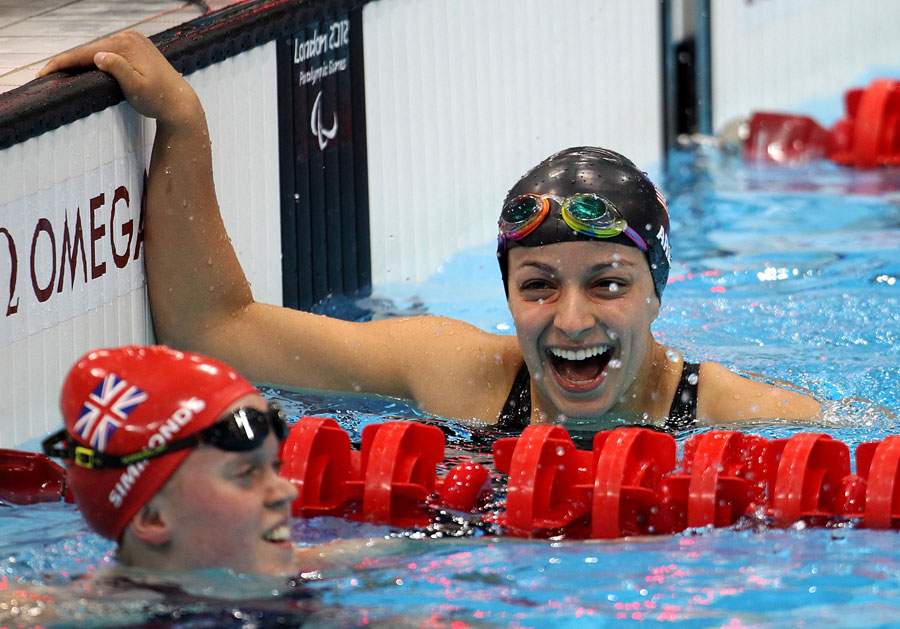 Victoria Arlen celebrates after beating Ellie Simmonds to gold