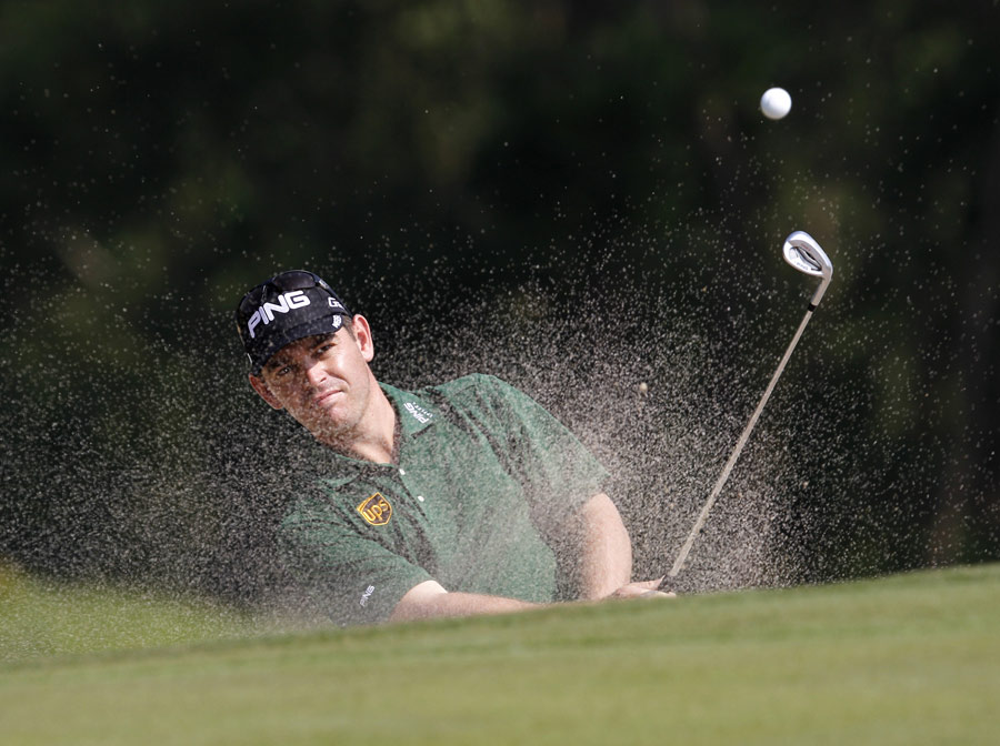 Louis Oosthuizen splashes out of a bunker