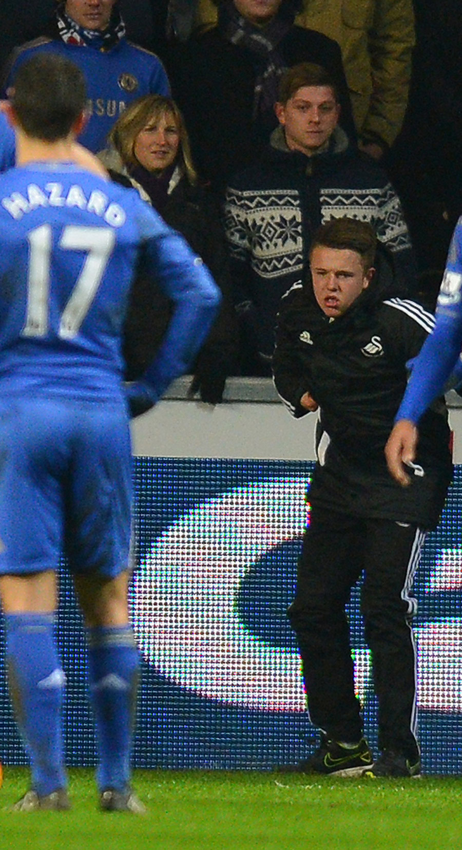 Eden Hazard looks on as the Swansea ballboy holds his side