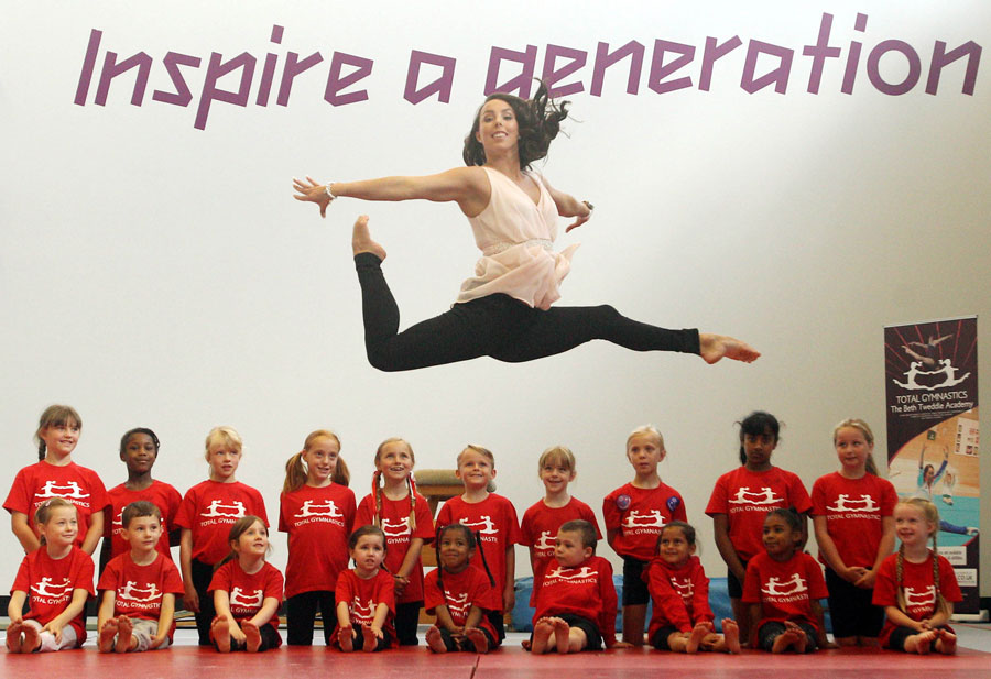 Beth Tweddle jumps above children from the Beth Tweddle Academy