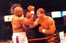 Tommy Morrison lands a blow on George Foreman