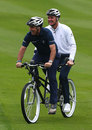 Paul McGinley and Justin Rose ride a tandem prior to the BMW Masters