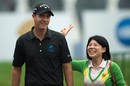 Nicolas Colsaerts jokes with a fan after the ninth hole of his second round