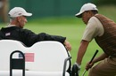 Tiger Woods chats to assistant coach Corey Pavin